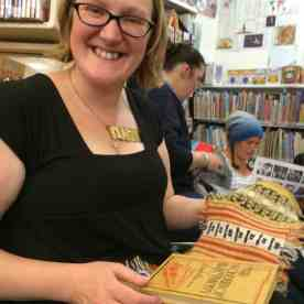 My woolly mucker Felix at the Shetland Library. She brought her Wonders of Electricity book and her inspired swatch