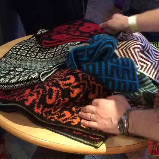 The hands of Nathan Taylor and some of his incredible double knitting designs