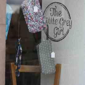 The Little Grey Girl stars in the Fluph window