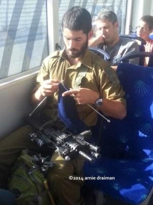 IDF Soldier Knitting on Bus  Arnie Draiman