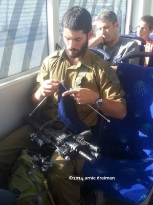 IDF Soldier Knitting on Bus  Arnie Draiman