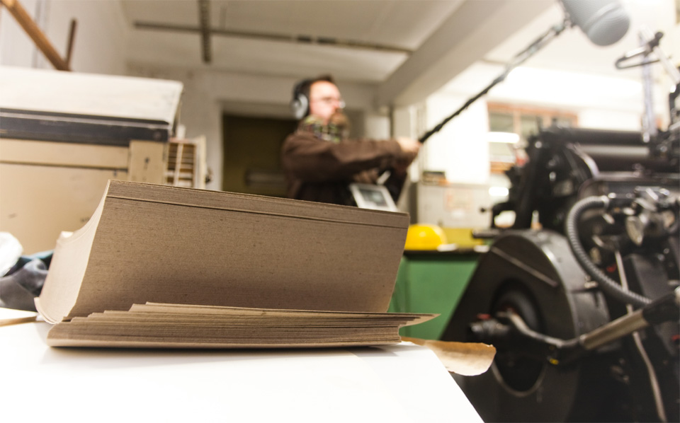 Patrick recording the sounds of the printing press where the CD sleeves for framework:500 were printed