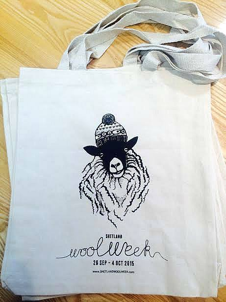 The official Shetland Wool Week 2015 bag designed exclusively for Shetland Wool Week by Felicity Ford AKA Knitsonik featuring our very own Baa-ble Hat by Donna Smith Designs