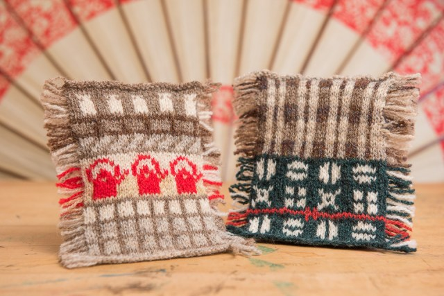Yumi's gorgeous swatches, commemorating stills from an old Japanese film; on the left, a red kettle and tatami mats translated into stranded colourwork; on the right, the woven fabric of a kimono and an obi transposed into knitting by Yumi Shimada