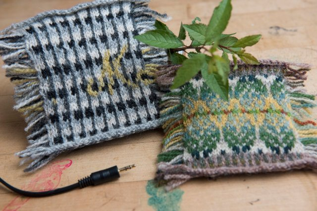 Muriel's knitted speaker postcard on the left, photographed with an audio cable; Yumi's leaves in the park swatch, on the right, photographed with foliage