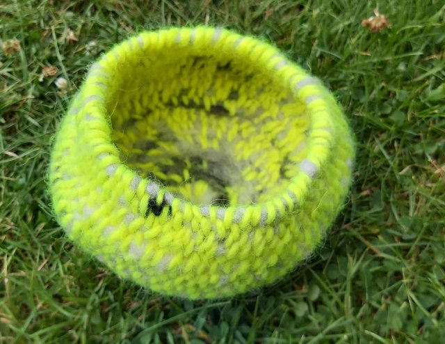 Basket made from neon yellow lopi wool and Jacob sheep roving