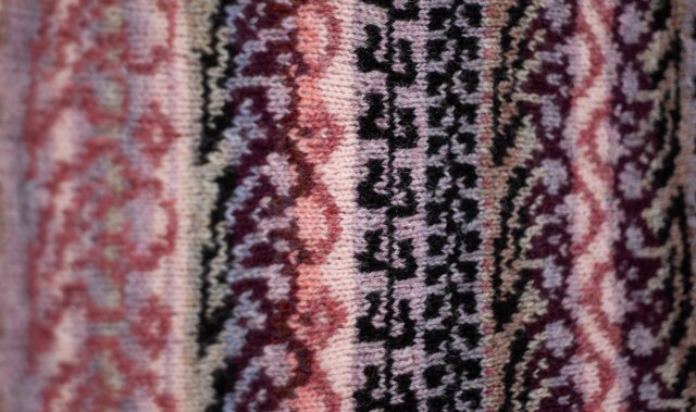 KNITSONIK swatch - a selection of swirly, busy, knitted patterns in dusky pinks, golds, browns and lilacs, all based on a cinnamon-pastilles tin