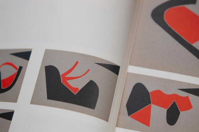 red, grey and black forms arranged in series, alongisde Geta Brătescu's notes, quoted below
