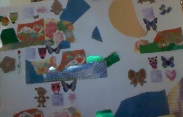 a grainy screenshot of the amazing set of different collage ideas spread across my niece's glorious page of play