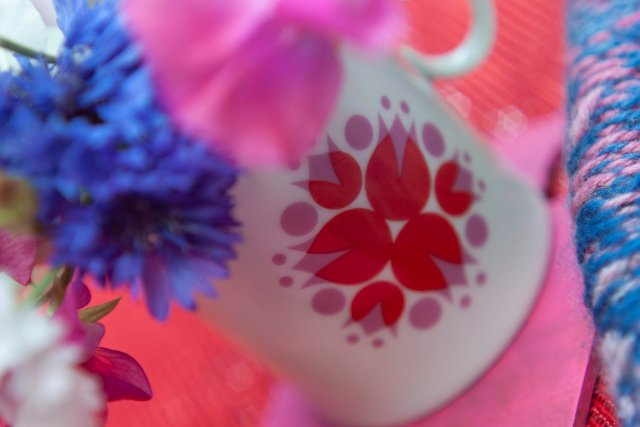 Glorious vintage jug featuring a delightful pink and red motif. Flowers are in it!