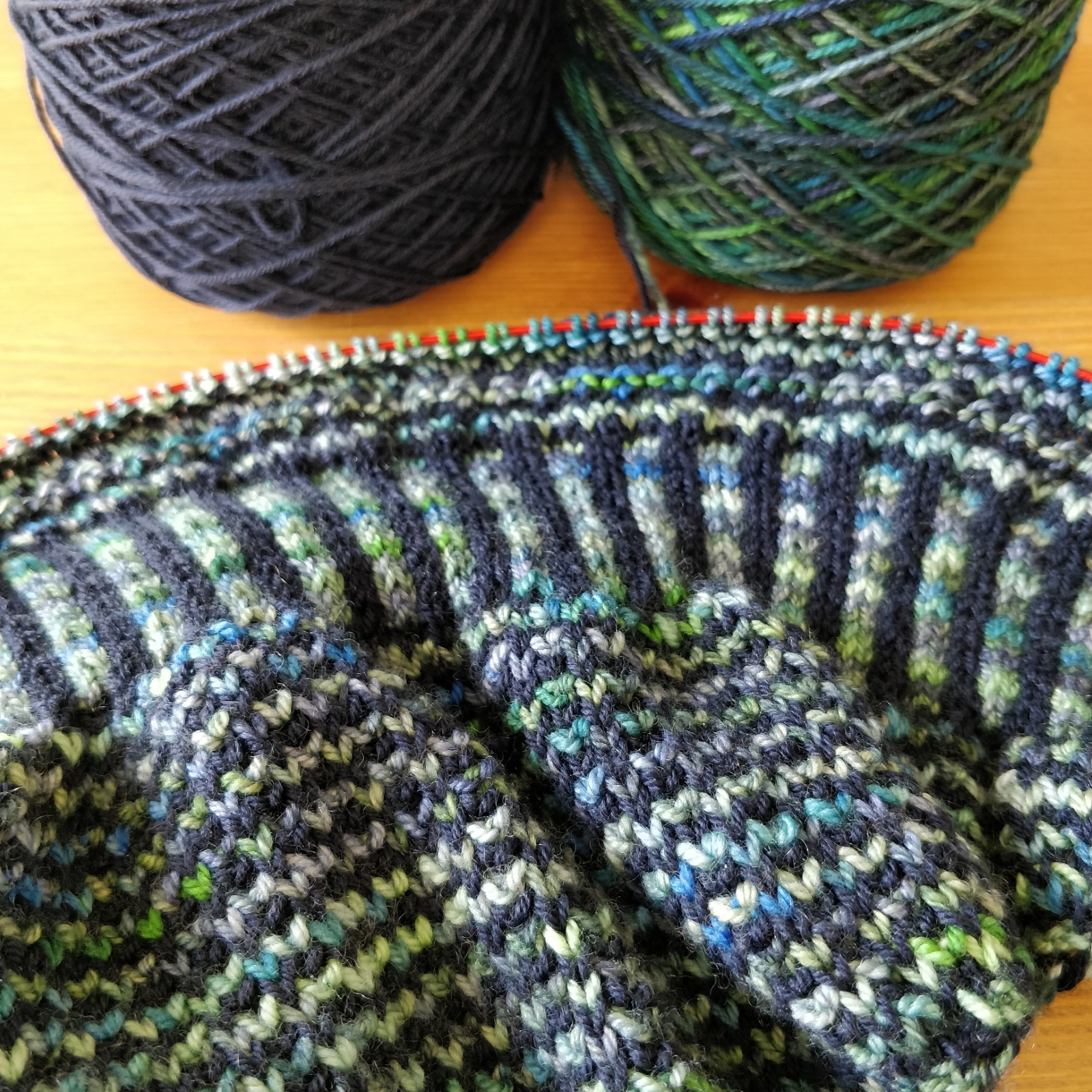 A closeup view of the green and blue stripes in the shawl. Horizontal stripe sections alternate with vertical.