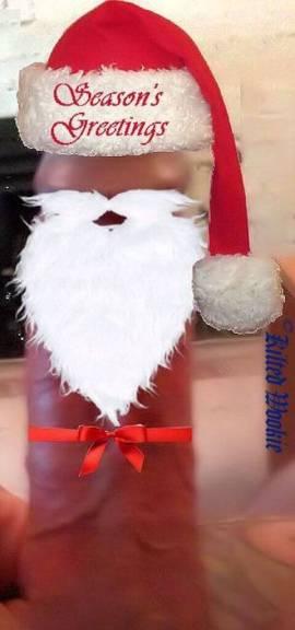 A big fat hard dick wearing a Santa hat and beard