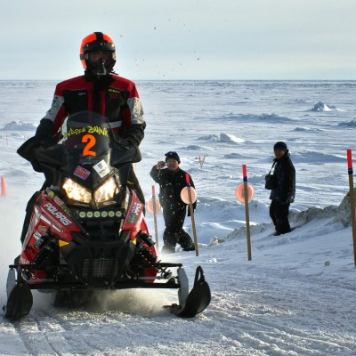 Iron Dog racers coming into Nome during the race in 2014. Photo: KNOM file.