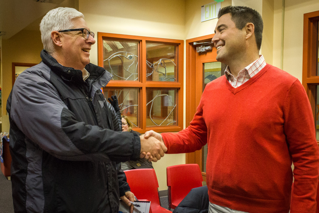 Upon resigning from the job in December, former Nome Public Schools Superintendent Steve Gast, left, shakes the hand of the district's newly-selected superintendent Shawn Arnold. Photo: Matthew F. Smith, KNOM.