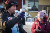 Aaron Burmeister, happy for a cup of coffee after Iditarod 2015.
