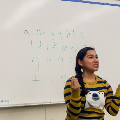 Marjorie Tahbone, the vice chair of Inuusiq, Inc., teaching an Inupiaq class at the Nome high school.