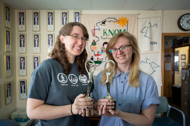 Courtney and Caitlin hold Communicator Awards