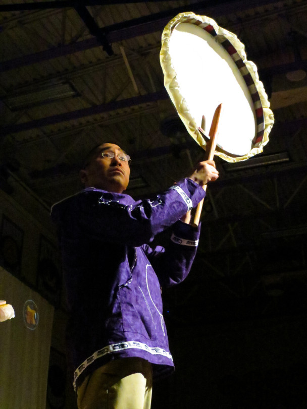 "A drummer helps lead the ""Heart of the Drums"" event, in which drummers from all the groups performed together. (Photo: Maddie Winchester, KNOM)"