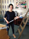 Margaret DeMaioribus helps replace KNOM's fleet of fluorescent tube lights with brighter, more energy-efficient LEDs. Photo: Ric Schmidt, KNOM.