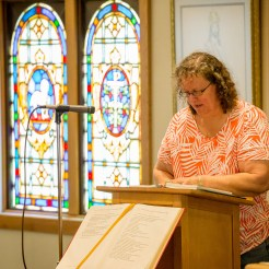 Lynette offers a reading during Mass