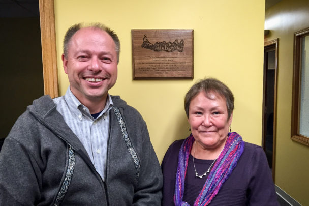 Kevin Fimon and Florence Busch next to the plaque marking the dedication of the Tom and Florence Busch Digital Studios
