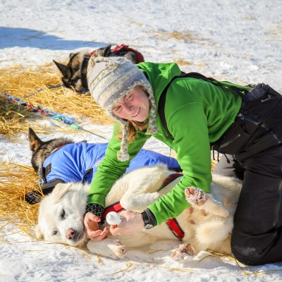 Katherine Keith tending to her dogs in Kaltag before departing for Unalakleet.