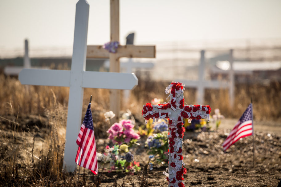 Small American flags placed near graves at Nome's cemetery