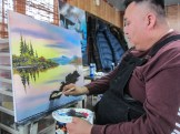 Don Henry adds foliage to his painting