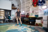 Crew member Geneviève Côté stands on the floor map of the Canadian Arctic in the converted helicopter hangar (Photo courtesy of Lia Nydes, 2017)