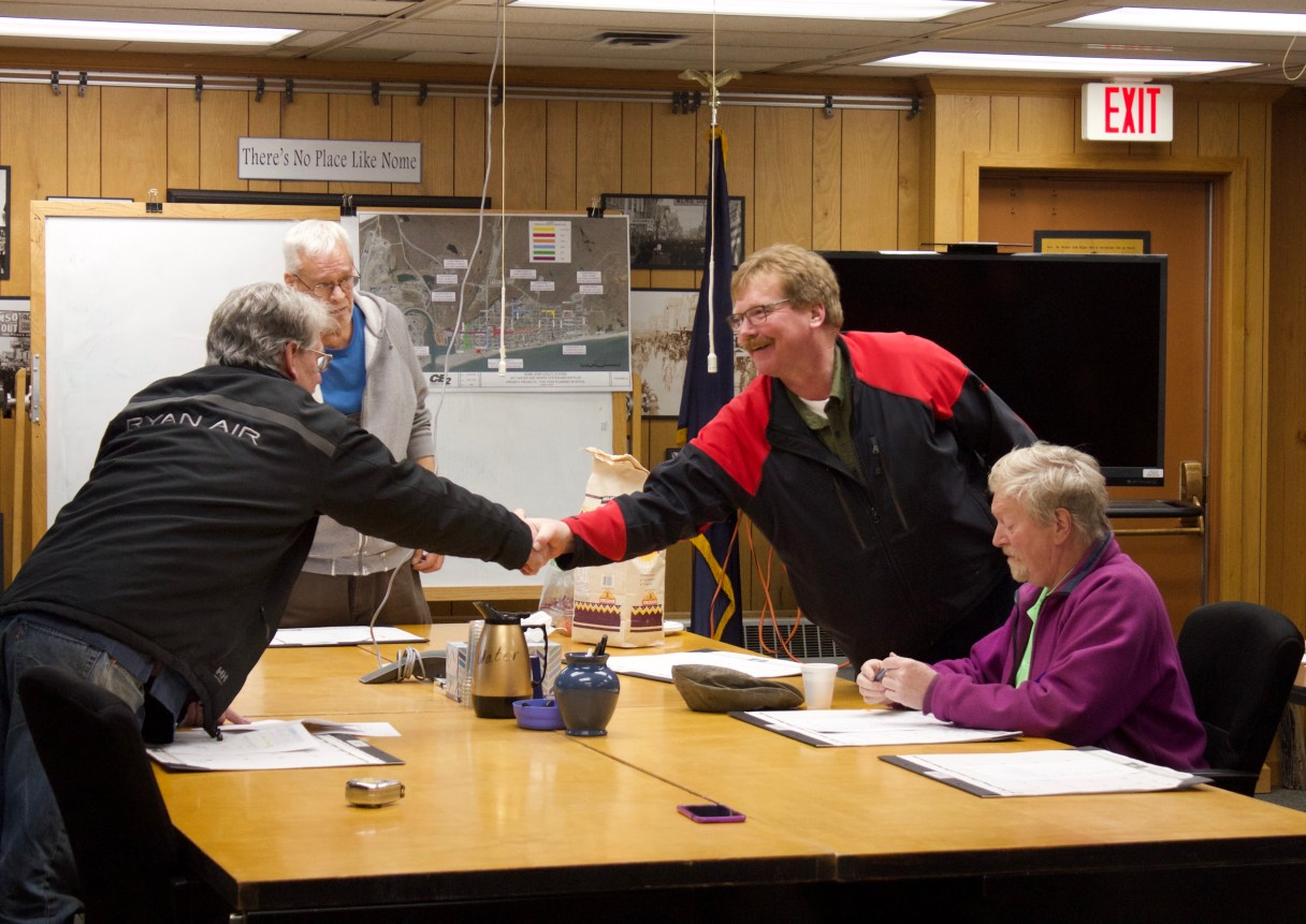 """Sparks shakes Brown's hand during Spark's last City Council meeting. The former Councilman completed the """"handoff"""" with Adam Martinson who will now hold Seat A on the Council. Photo Credit: Davis Hovey, KNOM (2017)"""