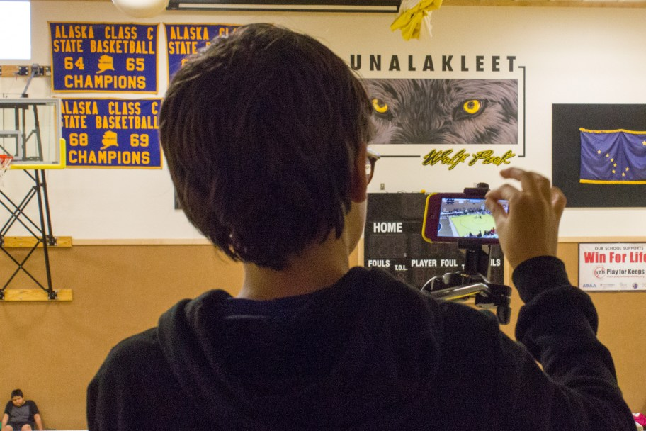 Student Broadcaster Alukka Ivanoff zooms in on a subject.