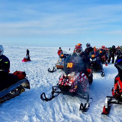 Racers line up at the start of the 2018 Nome-Golovin snowmachine race (Photo: Zoe Grueskin, KNOM)