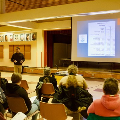 Superintendent Shawn Arnold discusses the Nome Public Schools fiscal year-19 draft budget at a public budget meeting (Photo: Gabe Colombo, KNOM)
