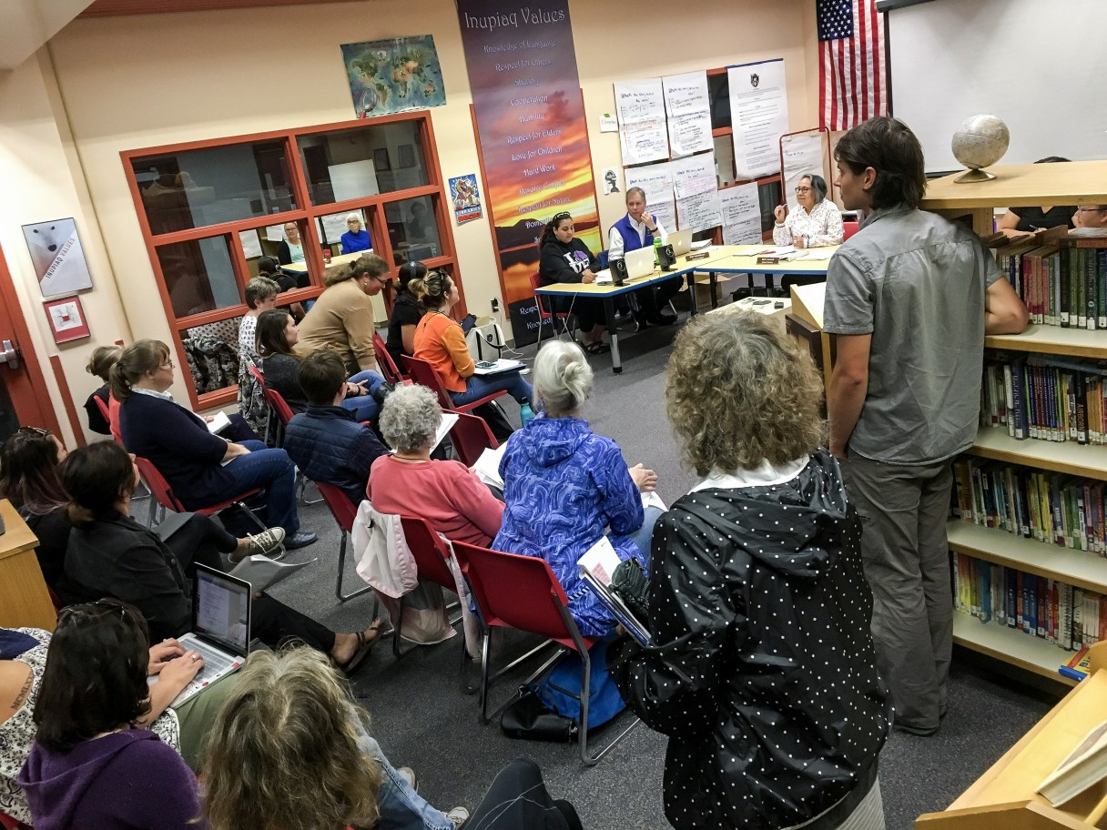 Gathering of Nome School Board members, teachers, and other attendees inside a room at the Nome Elementary School.