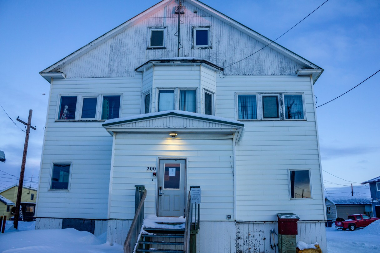 Exterior of off-white building in Nome at dawn.