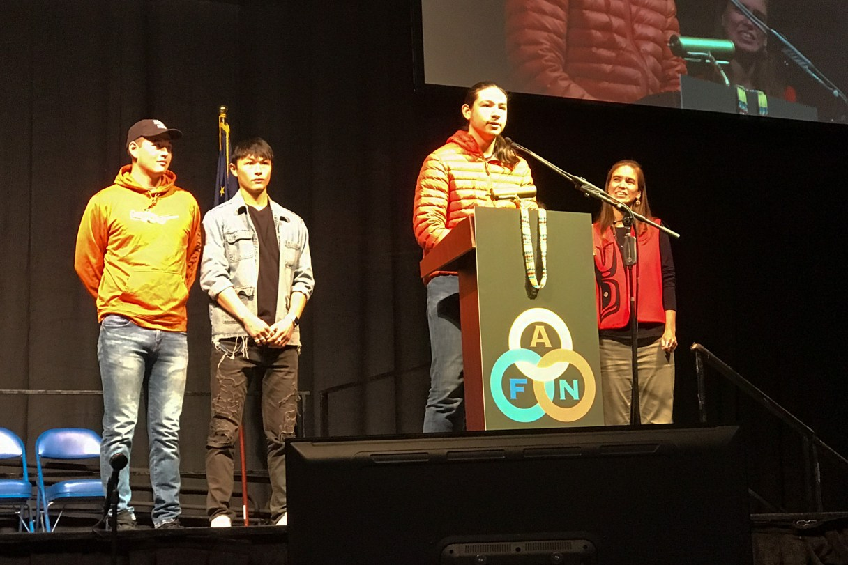 Four people on stage during AFN in 2019.