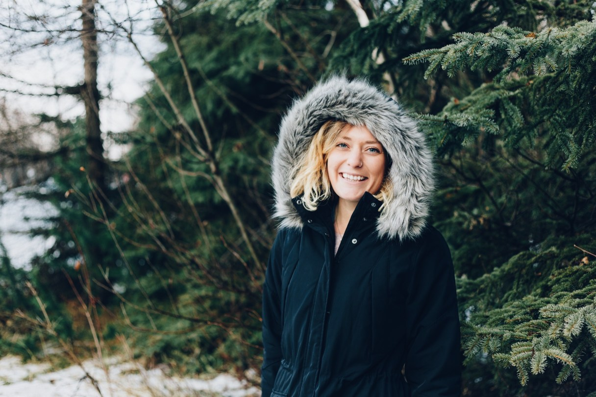 A woman wearing a parka in the winter