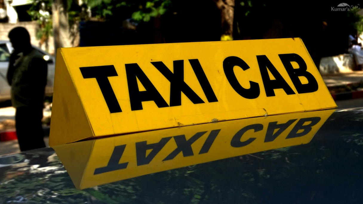 Picture of taxi cab sign on top of cab
