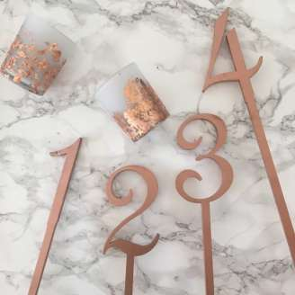 Copper Tablescape Decor, including candle holders and table numbers available for hire from London based UK wedding planners Knot & Pop