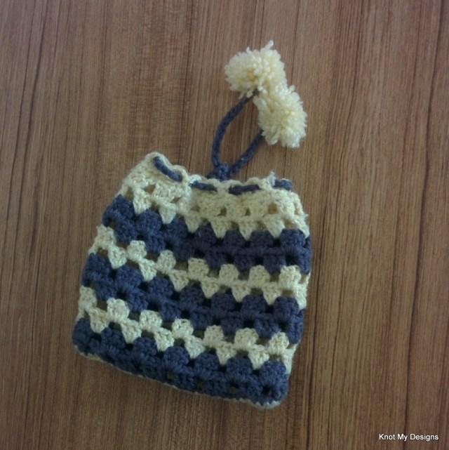 Free Crochet Granny Drawstring Ladies Handbag Pouch Pattern with pom pom - Knot My designs