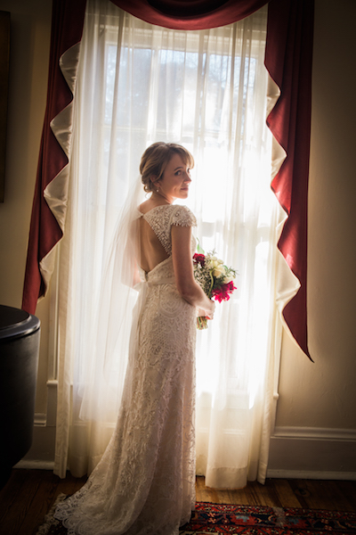 Bridal portrait of bride in front of window