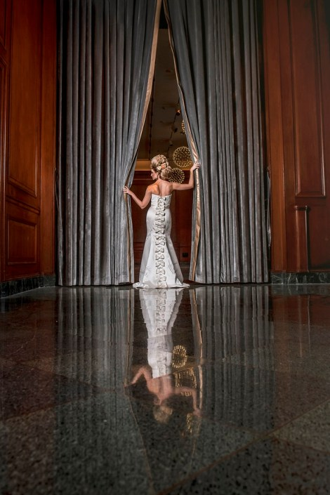 metal and gold wedding inspiration bridal portrait back view