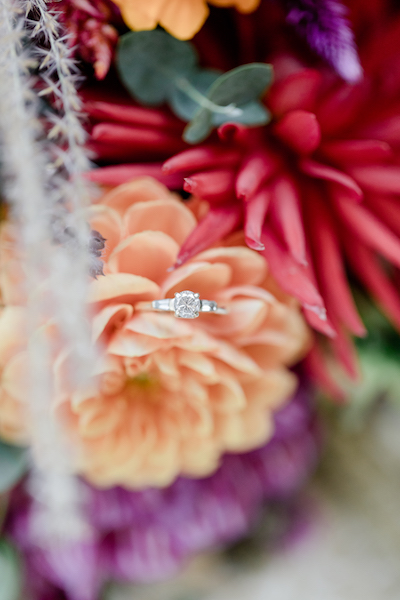 Engagement ring photographed in flowers