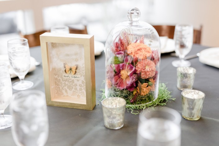 flowers in cloche centerpiece