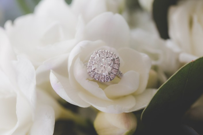 engagement ring nestled in a flower