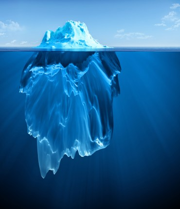 Iceberg floating on clear water