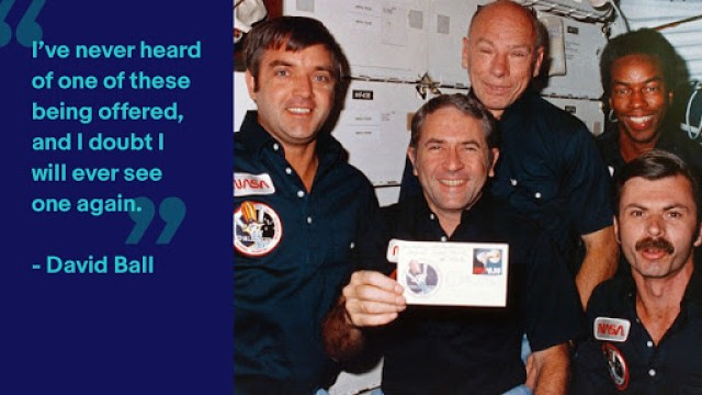 The crew of the STS 8 mission on the shuttle in 1983 with Richard Truly holding the stamp cover. Image credit to NASA