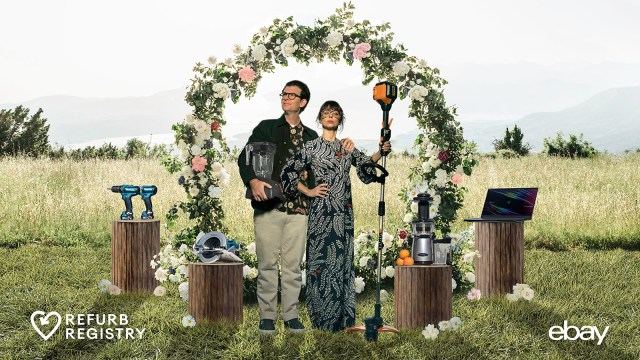 Moshe and Natasha under a floral arch