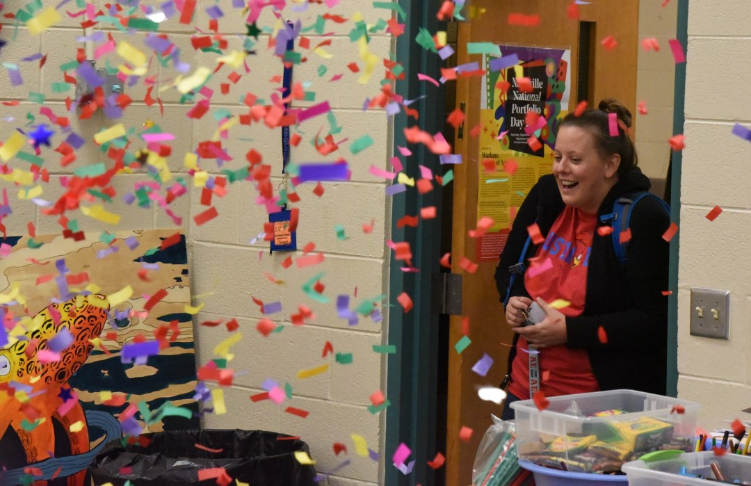 Laura Lee Thompson, an art teacher at Austin-East Magnet High School, is greeted with confetti at a news conference announcing her $15,000 TeacherPreneur grant.