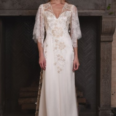 REVERUE 2017 COLLECTION Let's start with the French embroidered floral tulle sheath, with Claire's signature illusion back of delicate floral vines trailing along the spine. This wedding dress is the epitome of simple femininity. For dramatic and jaw-dropping worthy effect, top REVERIE with our stunning coat featuring lace sleeves, and a graceful floral embroidered tulle train. Reverie is available as shown with Ivory embroidery lined in Pearl, or with any of our silk color options